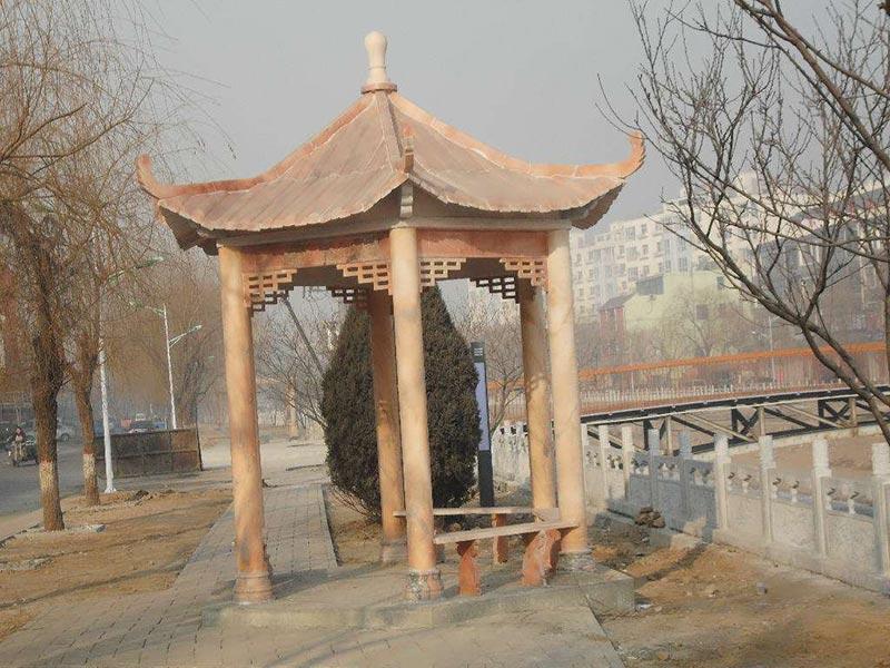 公园晚霞红石凉亭